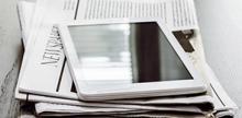 iPad on top of a newspaper